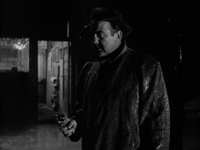 Cop Johnny Damico (Broderick Crawford) makes a mistake on a rainy night in Robert Parrish's The Mob (1951)