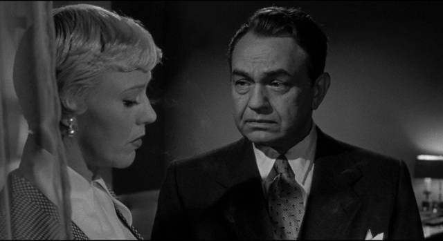 Prosecutor Lloyd Hallett (Edward G. Robinson) tries to awaken Sherry Conley (Ginger Rogers)'s sense of social responsibility in Phil Karlson's Tight Spot (1955)