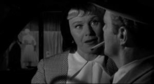 Sherry Conley (Ginger Rogers) doesn't like cop Vince Striker (Brian Keith) in Phil Karlson's Tight Spot (1955)