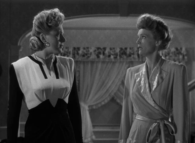 Ilona Carr (Evelyn Ankers) and Evelyn Sawtelle (Elizabeth Russell) conspire against Norman Reed (Chaney) in Reginald Le Borg's Weird Woman (1943)