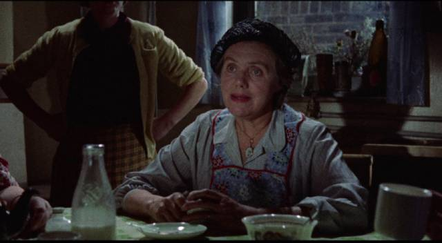 Mrs. Saparelli (Marjorie Rhodes) hears from Gideon (Jack Hawkins) that her daughter's murderer has been arrested in John Ford's Gideon's Day (1958)