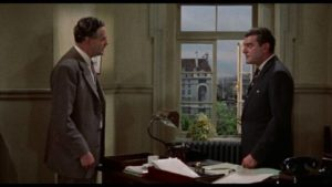 Chief Inspector George Gideon (Jack Hawkins) confronts a crooked colleague in John Ford's Gideon's Day (1958)