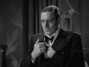 Bruce Vail (Colin Clive) refuses to accept that his wife has left him in Frank Borzage's History is Made at Night (1937)