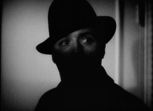 Paul Dumond (Charles Boyer) makes an ambiguously menacing entrance in Frank Borzage's History is Made at Night (1937)