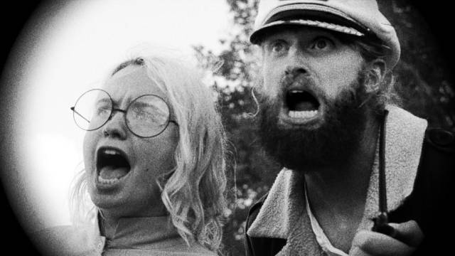 Captain Seafield (Ryland Brickson Cole Tews) and sonar expert Nedge Pepsi (Beulah Peters) are shocked by the Lake Michigan Monster (2018)