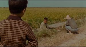 Inspector Park Doo-man (Song Kang-ho) encounters horror on a quiet summer day in Bong Joon-ho's Memories of Murder (2003)