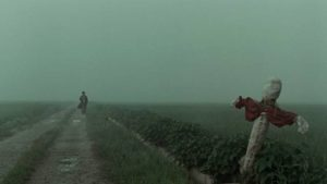 Inspector Seo Tae-yoon (Kim Sang-kyung) approaches a murder site in the fog in Bong Joon-ho's Memories of Murder (2003)