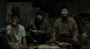 A pause in the interrogation of Baek Kwang-ho (Park No-shik) in Bong Joon-ho's Memories of Murder (2003)