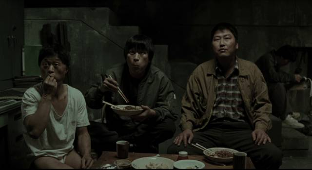 A pause in the interrogation of Baek Kwang-ho (Park No-shik) in Bong Joon-ho's Memories of Murder (2003)