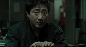 The investigation exposes Jo Byung-soon (Ryu Tae-ho)'s shameful secret in Bong Joon-ho's Memories of Murder (2003)
