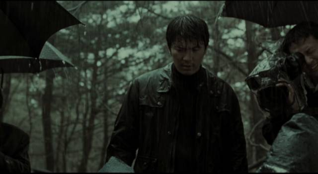 Inspector Seo Tae-yoon (Kim Sang-kyung) confronts the horror of a new murder for which he feels personally responsible in Bong Joon-ho's Memories of Murder (2003)