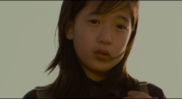 A young girl (Jeong In-seon) unwittingly reports an encounter with the killer years after the murders in Bong Joon-ho's Memories of Murder (2003)