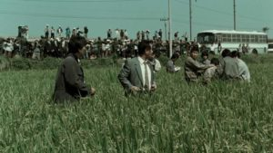 The police stage a public performance to display their first suspect in Bong Joon-ho's Memories of Murder (2003)