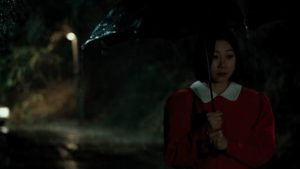 Officer Kwon Gwi-ok (Koh Seo-hee) as bait for the killer on a rainy night in Bong Joon-ho's Memories of Murder (2003)