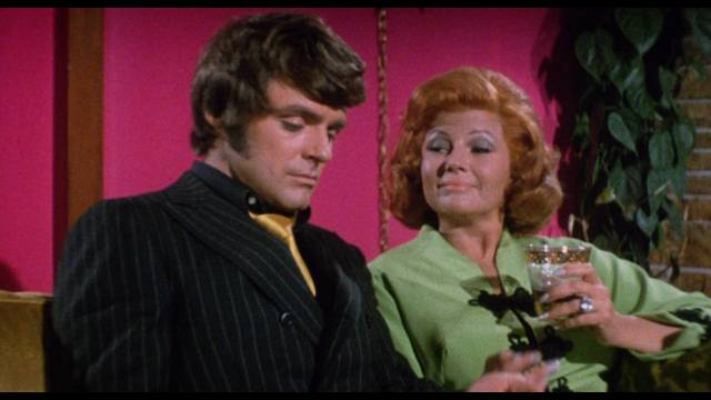 Gigolo Terry Shaw (Stephen Oliver) grows bored with rich wife Helen Golden (Rita Hayworth) in William Grefé's The Naked Zoo (1970)