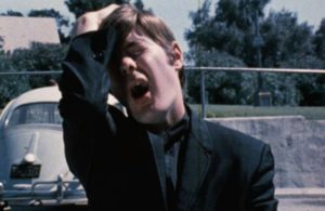 Slipped some LSD, Father John (John Darrell) has a crisis of faith in William Grefé's The Psychedelic Priest (1971)