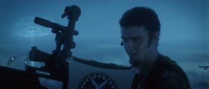 Private Pilot Abilone (Justin Timberlake) watches over the beach with a powerful sniper rifle in Richard Kelly's Southland Tales (2006)