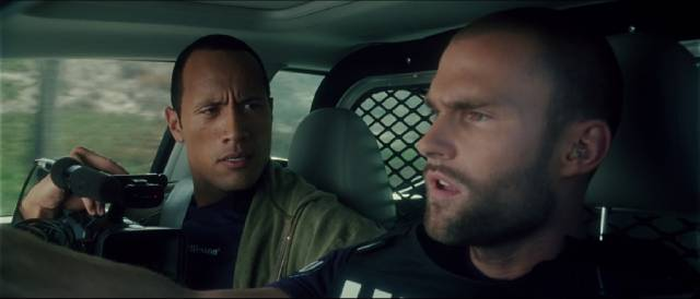 Action star Boxer Santaros (Dwayne Johnson) rides along with Officer Roland Taverner (Seann William Scott) in Richard Kelly's Southland Tales (2006)