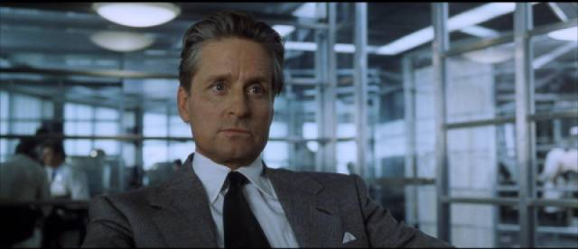 Nicholas Van Orton (Michael Douglas) listens impatiently to the corporate pitch in David Fincher's The Game (1997)
