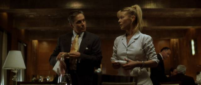 Nicholas offends waitress Kristine (Deborah Kara Unger) at his club in David Fincher's The Game (1997)