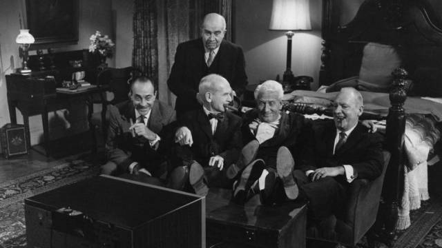 Frank Skeffington (Spencer Tracy) and his cronies laugh at the opposition's incompetent TV promotion in John Ford's The Last Hurrah (1958)