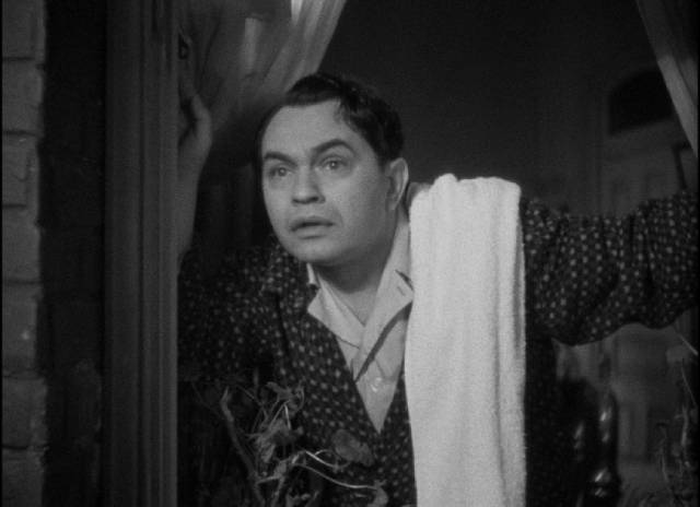 Arthur Ferguson Jones (Edward G. Robinson) realizes he'll be late for work for the first time in John Ford's The Whole Town's Talking (1935)
