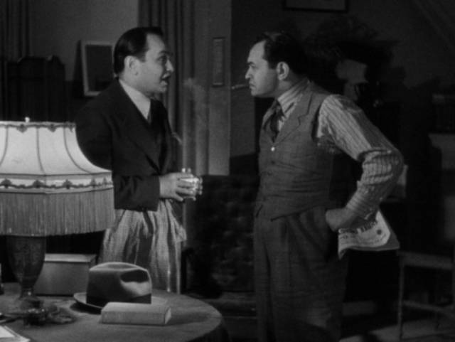 """""""Killer"""" Mannion sees an opportunity to take advantage of his resemblance to Arthur (Edward G. Robinson) in John Ford's The Whole Town's Talking (1935)"""