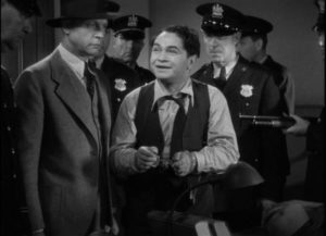 """The police, mistaking him for """"Killer"""" Mannion, try to force a confession out of Arthur (Edward G. Robinson) in John Ford's The Whole Town's Talking (1935)"""