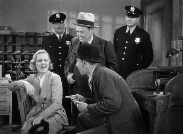 Wilhelmina Clark (Jean Arthur) entertains herself by playing the gangster's moll for the cops in John Ford's The Whole Town's Talking (1935)