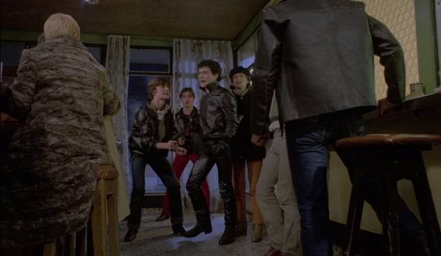 The gang terrorize staff and customers in a small cafe in Tomas Aznar's Beyond Terror (1980)