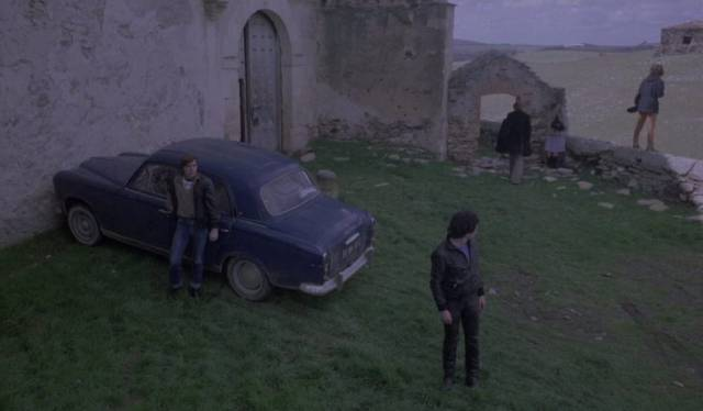 The gang take temporary refuge in an abandoned church in Tomas Aznar's Beyond Terror (1980)