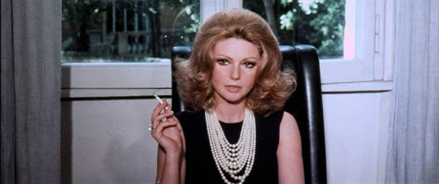 Head designer Françoise Ballais (Sylva Koscina) is inconvenienced when her models begin to die in Sergio Pastore's The Crimes of the Black Cat (1972)