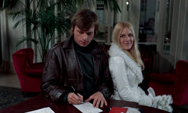 Stefan (John Karlen) and his naive bride Valerie (Danielle Ouimet) check in at the empty hotel in Harry Kümel's Daughters of Darkness (1971)