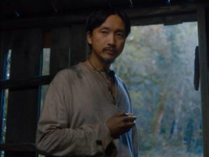 King Lu (Orion Lee) establishes a domestic space in Kelly Reichardt's First Cow (2020)