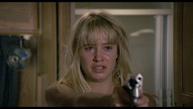 Kidnapped Daniela Foster (Josie Bissett) has to fight for her life in Umberto Lenzi's Hitcher in the Dark (1989)