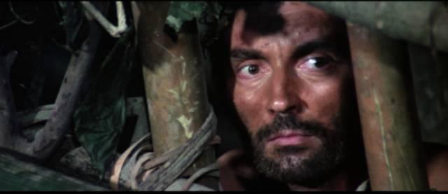 Oil prospector Robert Harper (Massimo Foschi) is caught by cannibals in Ruggero Deodato's Jungle Holocaust (1977)
