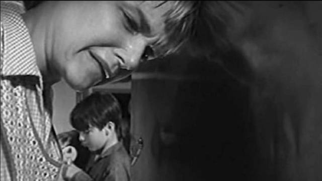 A terrified mother prays with her child in Frank Perry's Ladybug Ladybug (1965)