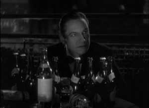 Writer Jerry Corbett (Frederic March) is drunkenly amused by Joan (Sylvia Sidney) in Dorothy Arzner's Merrily We Go to Hell (1932)