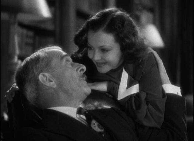 Joan (Sylvia Sidney) assures her indulgent father (George Irving) that Jerry (Frederick March) is really okay in Dorothy Arzner's Merrily We Go to Hell (1932)