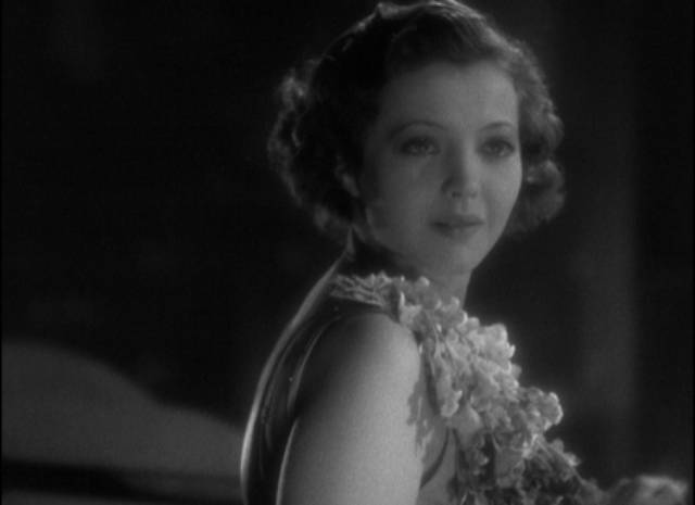 Joan (Sylvia Sidney) notices someone on the balcony with her in Dorothy Arzner's Merrily We Go to Hell (1932)