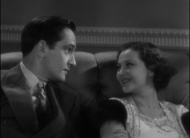Joan (Sylvia Sidney) is attracted to Jerry (Frederic March)'s casually offhand attitude in Dorothy Arzner's Merrily We Go to Hell (1932)
