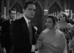 Jerry (Frederic March) seems uncomfortably distracted at his own wedding to Joan (Sylvia Sidney) in Dorothy Arzner's Merrily We Go to Hell (1932)
