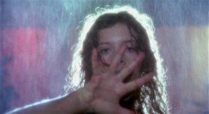 A victim seen through the eyes of the killer in Lucio Fulci's Murder-Rock: Dancing Death (1984)