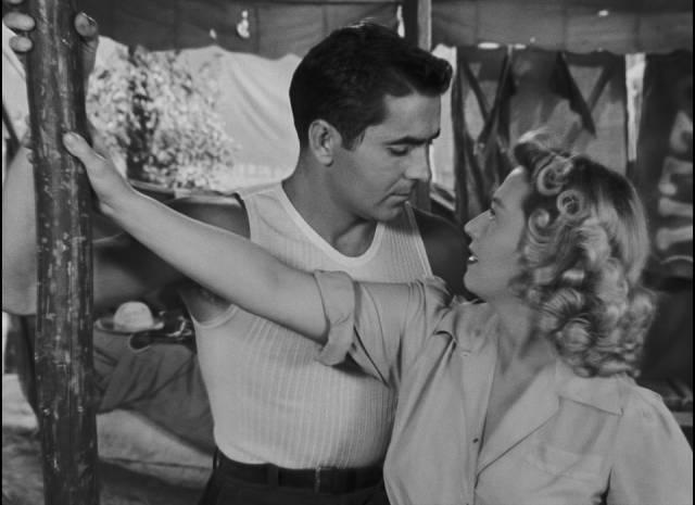 Stanton Carlisle (Tyrone Power) uses his charm on Zeena (Joan Blondell) in Edmund Goulding's Nightmare Alley (1947)