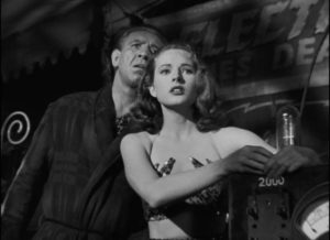 Molly (Coleen Gray) and her protector Bruno (Mike Mazurki) watch Stan (Tyrone Power) use his skilful banter on the local sheriff in Edmund Goulding's Nightmare Alley (1947)