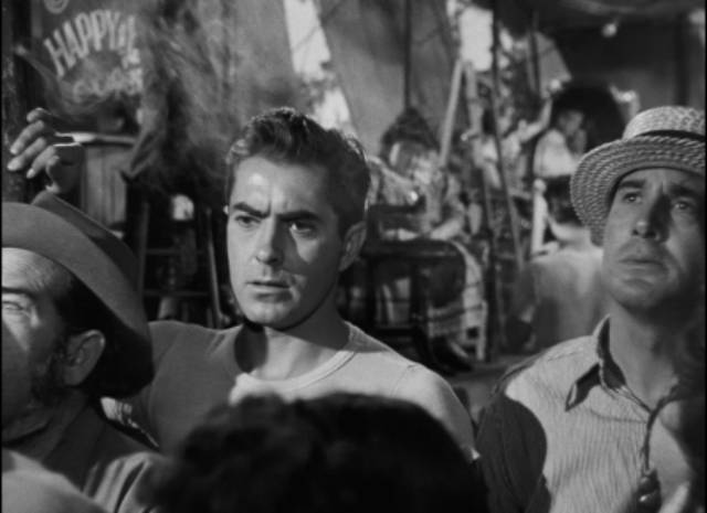 Stan (Tyrone Power) is fascinated by one particular sideshow attraction in Edmund Goulding's Nightmare Alley (1947) ...