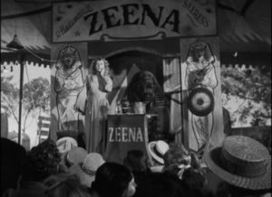 Zeena (Joan Blondell) performs her fake psychic act on the midway in Edmund Goulding's Nightmare Alley (1947)