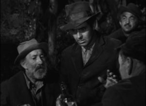 """Stan (Tyrone Power) is reduced to impressing other drunks with his """"psychic"""" powers in Edmund Goulding's Nightmare Alley (1947)"""