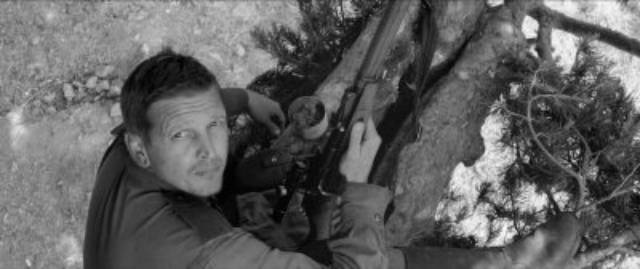 A Red Army sniper (Barry Pepper) also helps Joska (Petr Kotlar) in Václav Marhoul's The Painted Bird (2019)