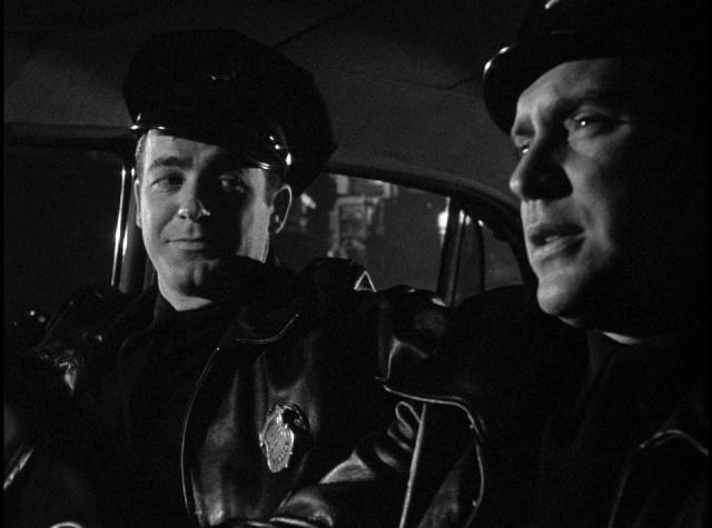 Officer Dan Purvis (Edmond O'Brien) shows rookie Rocky Barnes (Mark Stevens) the ropes in Gordon Douglas's Between Midnight and Dawn (1950)